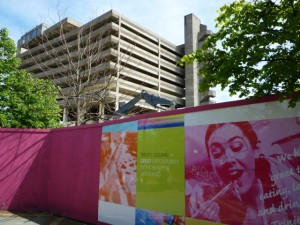 Hoardings promoting the new surround the old (18 Jun 2010). Photograph by Graham Soult
