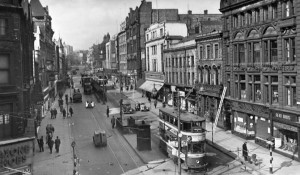 Old postcard of Briggate prior to Woolworths rebuilding