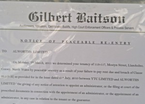 'Notice of Peaceable Re-entry' at Alworths, Llandudno (7 Mar 2011). Photograph by Dave Roberts