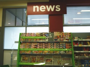 Newspapers, Asda Supermarket, Gateshead (8 Aug 2011). Photograph by Graham Soult