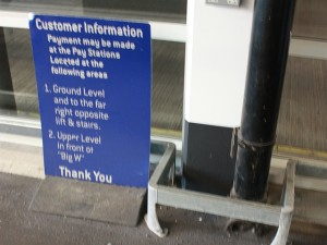 Notice by travelator, former Big W, Loughborough (15 Dec 2011). Photograph by Steve Hack
