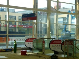 Travelators viewed from Tesco Extra, Gateshead, with Trinity Square and Costa behind (17 May 2013). Photograph by Graham Soult