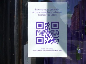 Shrewsbury wine merchant Tanners using a QR code to drive traffic to its website (10 Jun 2013). Photograph by Graham Soult